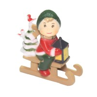Child on Snow Sledge with Tree and Lantern Decoration